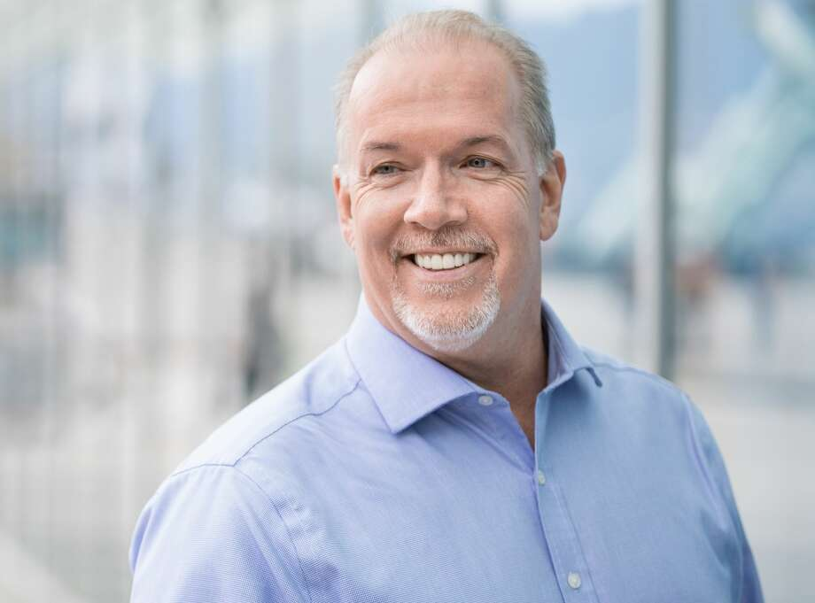 """British Columbia Premier John Horgan welcomes Gov. Inslee for a speech to the British Columbia Legislature. """"No one heckled you,"""" said Horgan, who gets a daily razzing at question period when the Legislature is in session. Photo: New Democratic Party"""