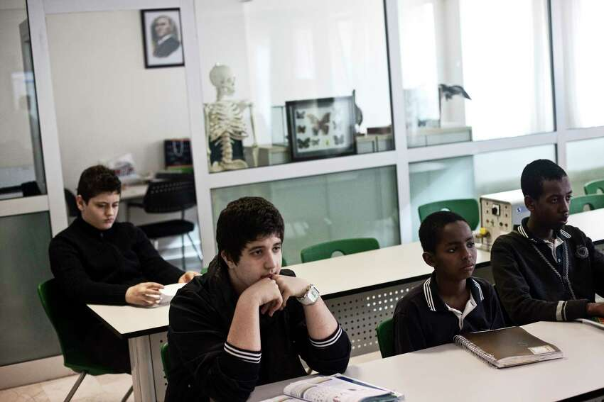 Students attend a biology class at a Fethullah Gulen school in Istanbul, March 16, 2012. (Daniel Etter/The New York Times)