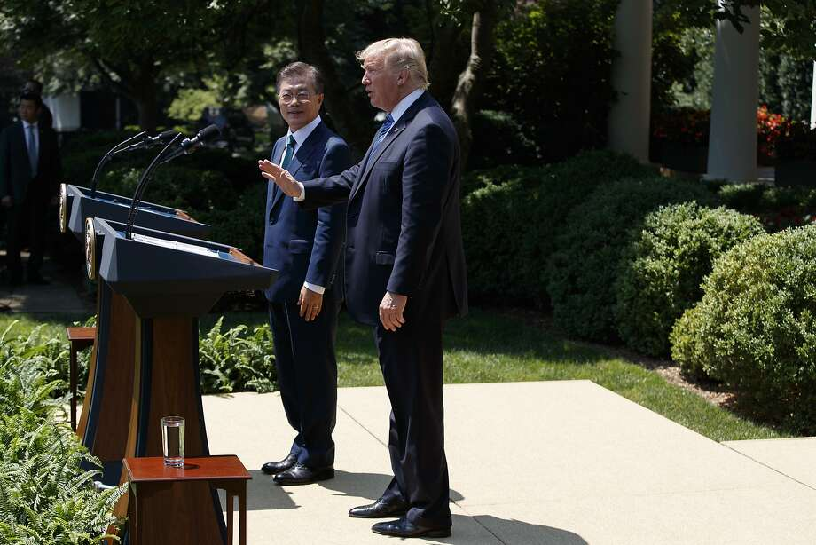 South Korean President Moon Jae-in watches as President Donald Trump waves after they spoke in the Rose Garden of the White House in Washington, Friday, June 30, 2017. (AP Photo/Evan Vucci) Photo: Evan Vucci, Associated Press