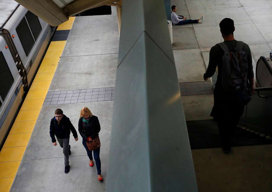 A BART train pulls away from Millbrae Station. Thirteen years after the station opened, ridership at the hub that connects BART and Caltrain hasn't been what planners envisioned. Photo: Leah Millis, The Chronicle