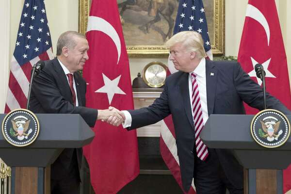 President Donald Trump shakes hands with Recep Tayyip Erdogan, Turkey's president, at the White House Tuesday. MUST CREDIT: Michael Reynolds, Bloomberg