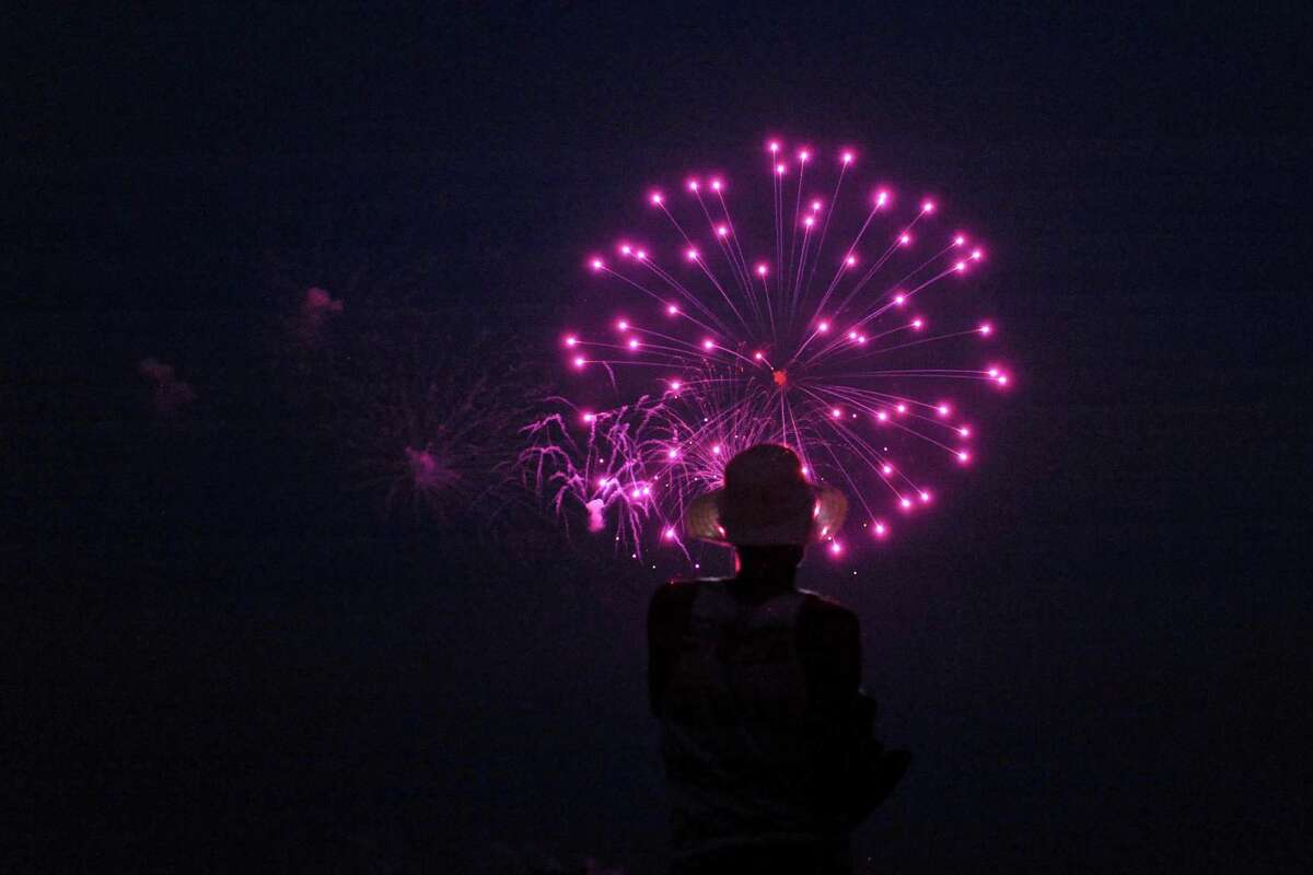 Photos of people enjoying Calf Pasture Beach at Norwalk's annual Fourth of July fireworks display on Sunday, July 3, 2016.