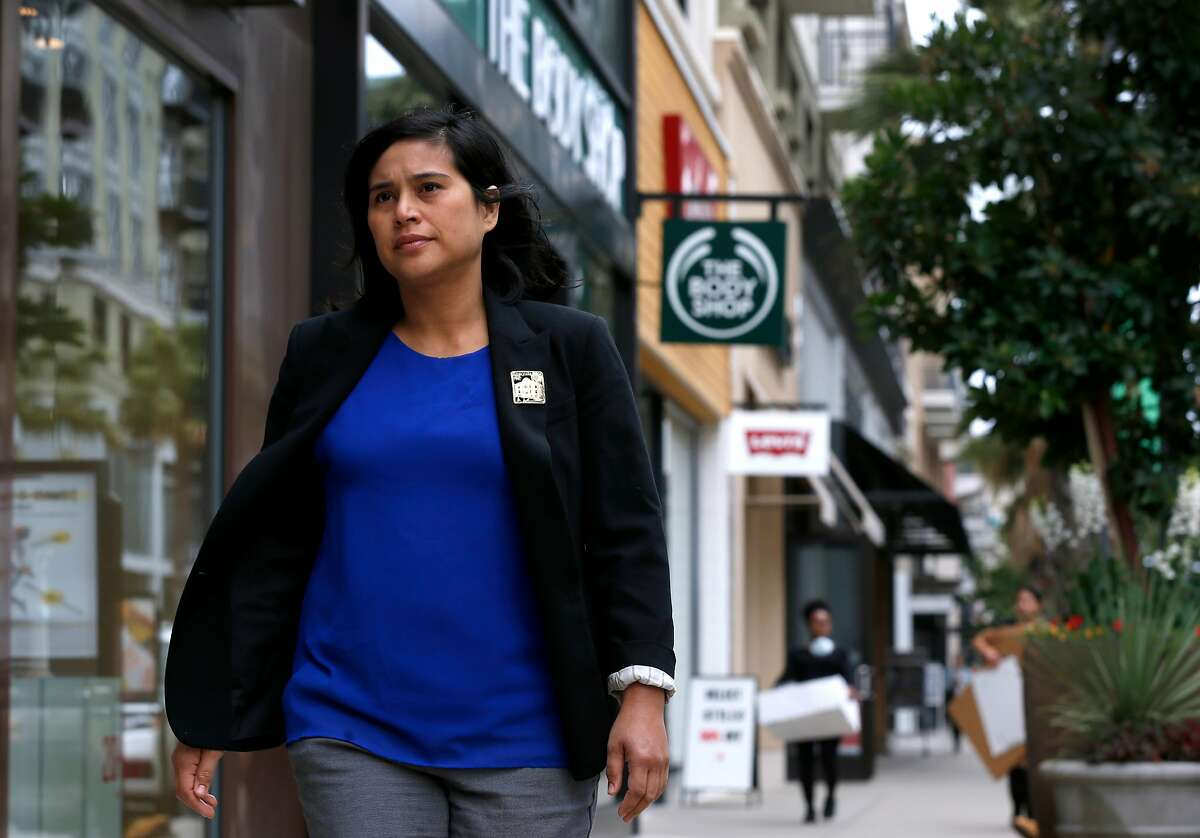 Emeryville city councilwoman Dianne Martinez visits the Bay Street shopping district in Emeryville, Calif. on Friday, June 30, 2017. A fair workweek ordinance, passed unanimously by the Emeryville city council, goes into effect July 1.