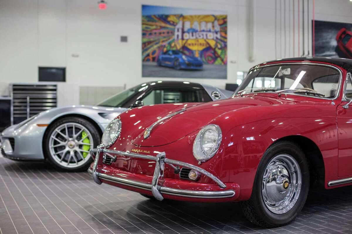 A Porsche 918 Spyder and a Porsche 1600 in the garage of a brand new flagship Porsche dealership on the north side of Houston Thursday June 29, 2017. (Michael Starghill, Jr.)