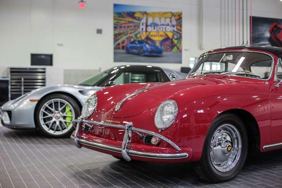 A Porsche 918 Spyder And A Porsche 1600 In The Garage Of A Brand New  Flagship