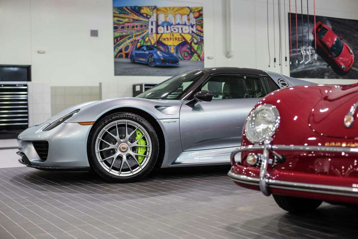 Details of a Porsche 918 Spyder and a Porsche 1600 in the garage of a brand new flagship Porsche dealership on the north side of Houston Thursday June 29, 2017. (Michael Starghill, Jr.)