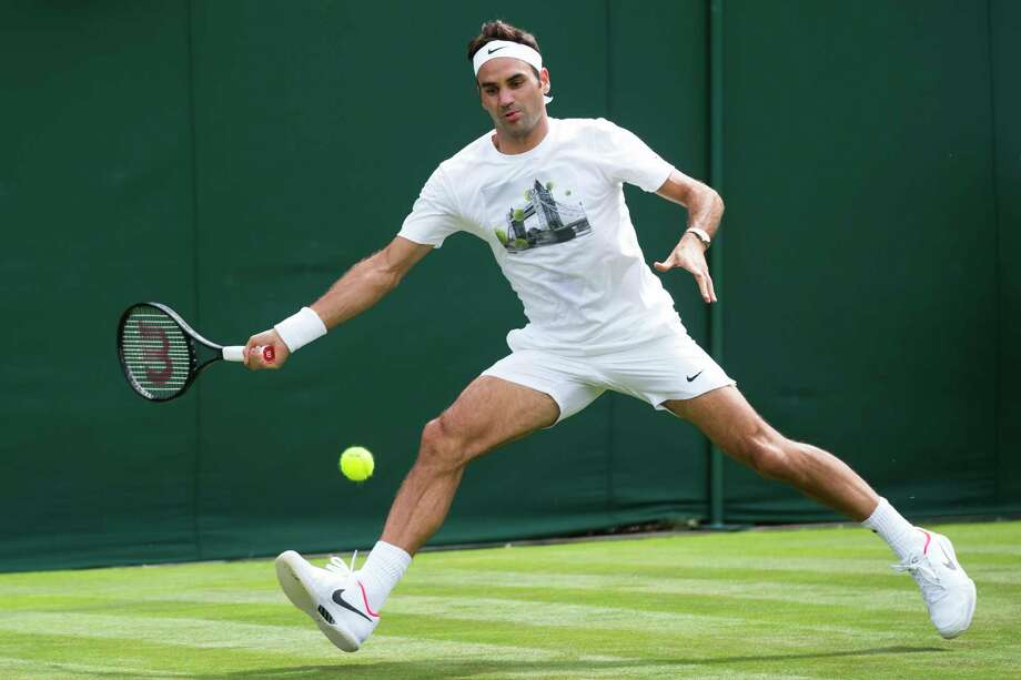 Roger Federer of Switzerland competes during a training session at the All England Lawn Tennis Championships in Wimbledon, London, Friday, June 30, 2017.  (Peter Klaunzer/Keystone via AP) Photo: Peter Klaunzer, SUB / © KEYSTONE / PETER KLAUNZER
