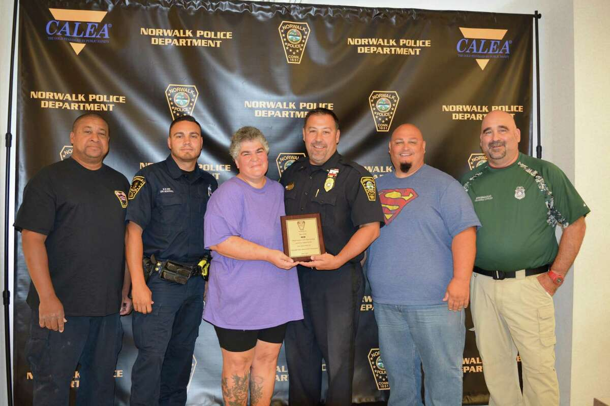 Pictured from left to right Sgt. Peter White, Officer Ricky Montanez, Sue Czel, Lt. Marc Lepore, Officer Mark Suda and Officer Ron Spagnuolo.