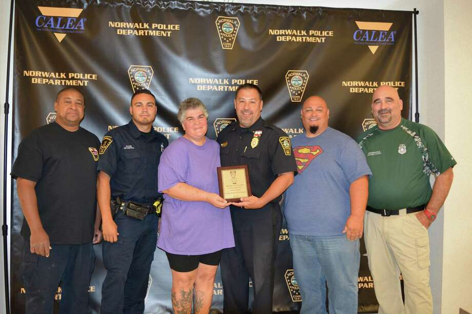 Pictured from left to right Sgt. Peter White, Officer Ricky Montanez, Sue Czel, Lt. Marc Lepore, Officer Mark Suda and Officer Ron Spagnuolo. Photo: Contributed Photo