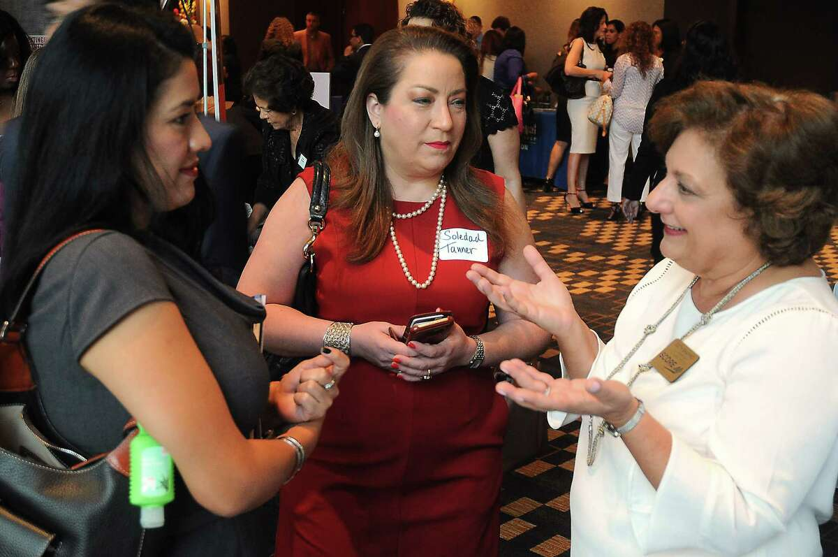 From left: Marcella Quata, Soledad Tanner and Beth Shapiro talk at the SBA table at the Hispanic Chamber of Commerce's annual Women's Leadership Conference and Business Expo at the Royal Sonesta Hotel Friday June 30, 2017. (Dave Rossman Photo)