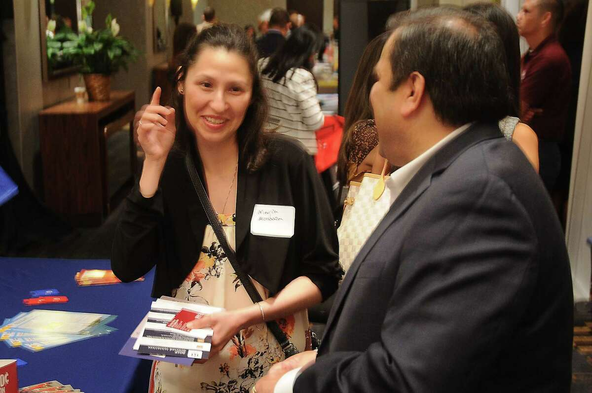 Maria Mendoza talks with Dennis Silva from TDECU at the Hispanic Chamber of Commerce's annual Women's Leadership Conference and Business Expo at the Royal Sonesta Hotel Friday June 30, 2017. (Dave Rossman Photo)