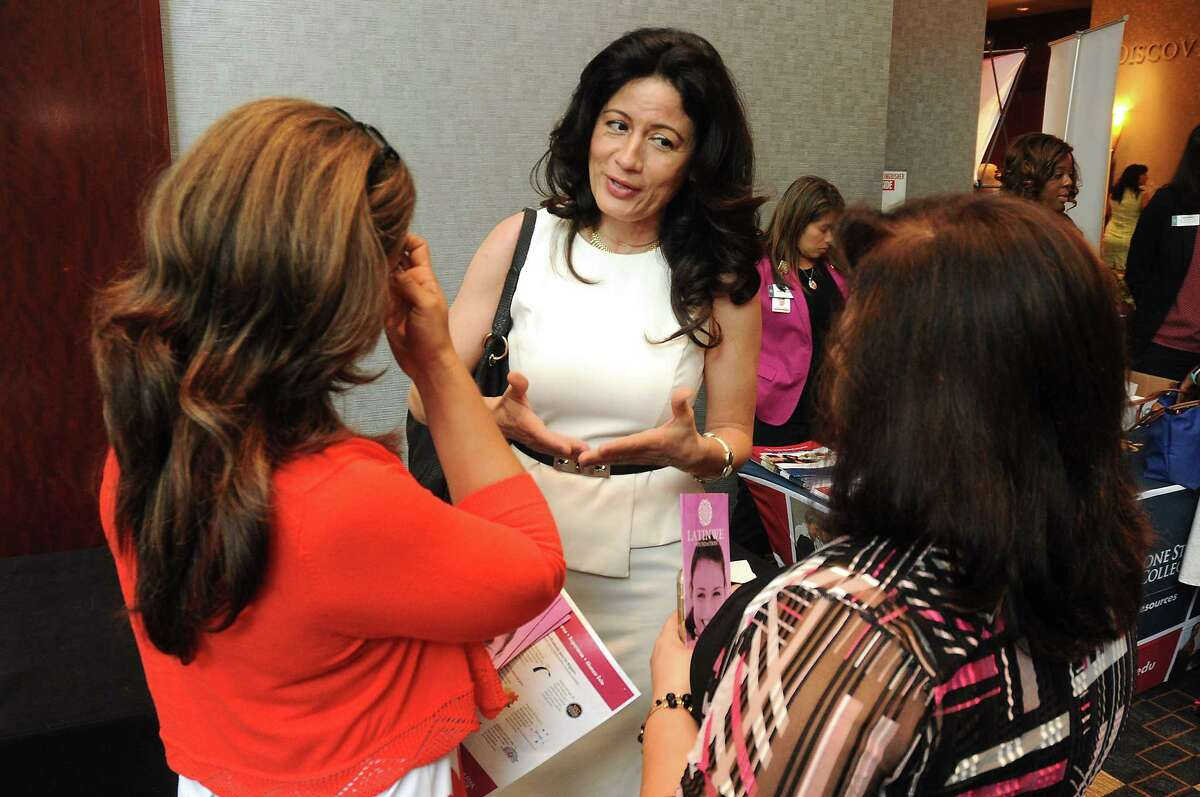 From left: Lizzette Diaz, Flor Dimassi and Maria Cantu-Ondarza chat before the Hispanic Chamber of Commerce's annual Women's Leadership Conference and Business Expo at the Royal Sonesta Hotel Friday June 30, 2017. (Dave Rossman Photo)