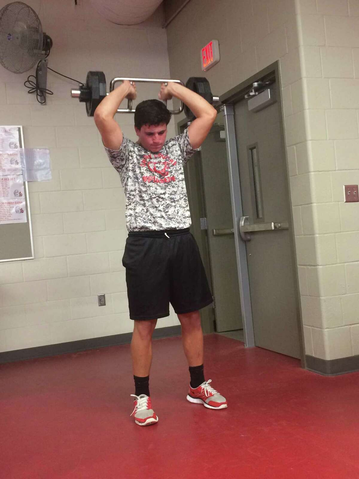 Hunter Bailey works on a set of tricep extensions at the Crosby football EDGE summer conditioning camp
