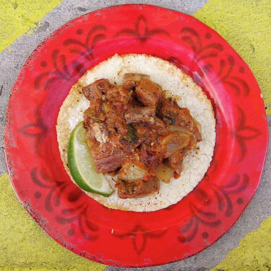 Lengua guisada taco on a handmade corn tortilla from El Sabrosito. Photo: Mike Sutter /San Antonio Express-News