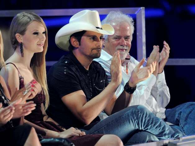 NASHVILLE, TN - JUNE 09: Musicians Taylor Swift and Brad Paisley look on from the crowd at the 2010 CMT Music Awards at the Bridgestone Arena on June 9, 2010 in Nashville, Tennessee.  (Photo by Jason Merritt/Getty Images) *** Local Caption *** Taylor Swift;Brad Paisley Photo: Jason Merritt, Getty Images / 2010 Getty Images