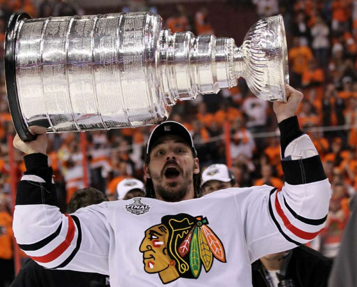 PHILADELPHIA - JUNE 09: Brent Sopel #5 of the Chicago Blackhawks hoists the Stanley Cup after the Blackhawks defeated the Philadelphia Flyers 4-3 in overtime to win the Stanley Cup in Game Six of the 2010 NHL Stanley Cup Final at the Wachovia Center on June 9, 2010 in Philadelphia, Pennsylvania. (Photo by Bruce Bennett/Getty Images) *** Local Caption *** Brent Sopel