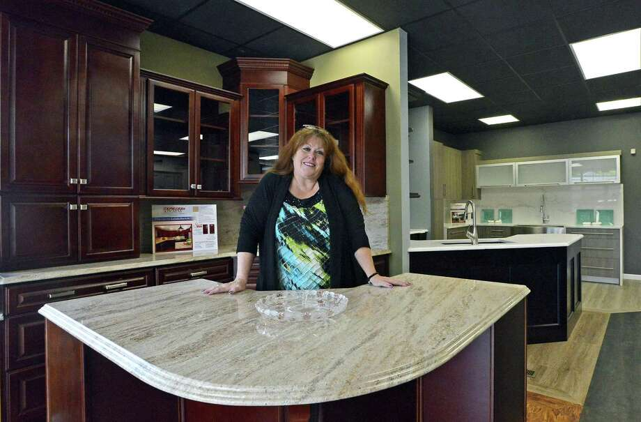 Deborah Wolak Project Manager Stands In The Showroom Of New Express Kitchens