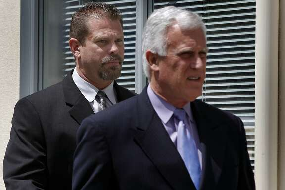 Former state drug agent Norman Wielsch (left) follows his attorney Michael Cardoza into the Contra Costa County Superior Court for a hearing in Walnut Creek, Calif. on Thursday, April 21, 2011. Wielsch is accused of stealing drugs from evidence lockers and handing them off to fellow defendant Christopher Butler, who then illegally resold them.