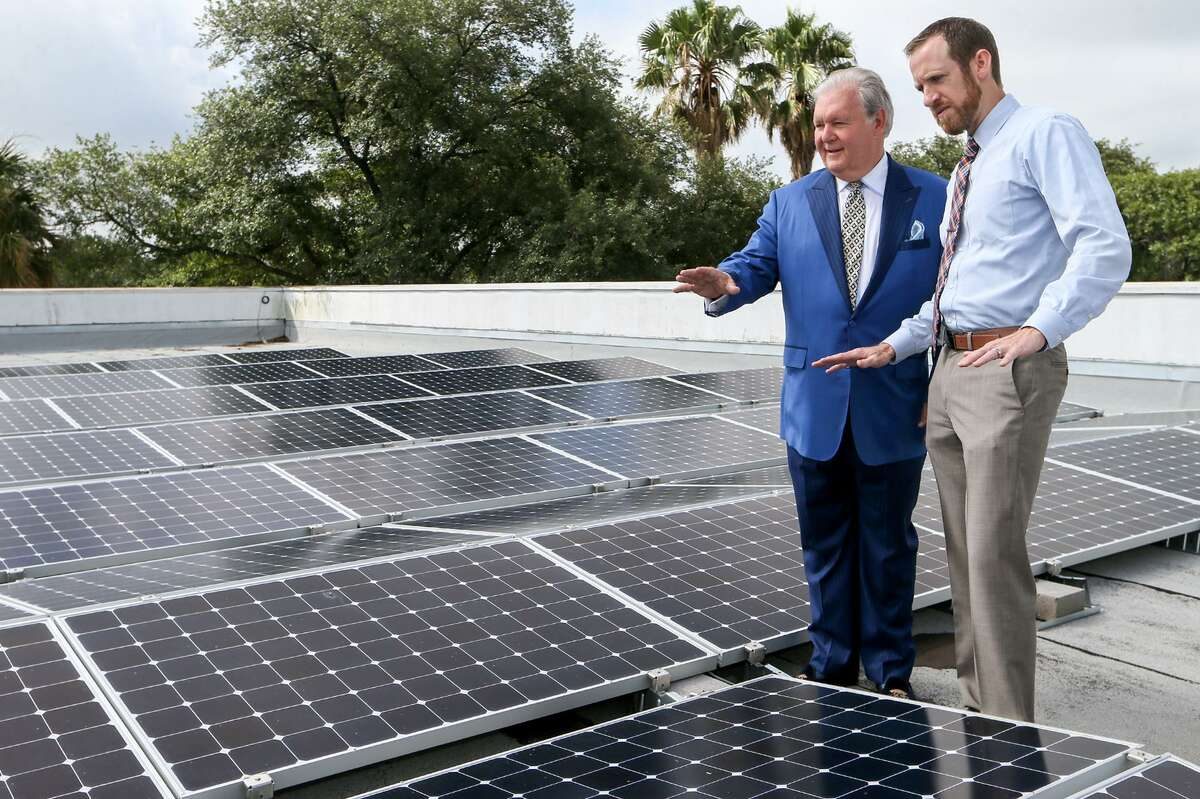 Dick Tips (left), chairman and CEO of Mission Park Funeral Chapels & Cemeteries, looks over an installation of solar panels on the rooftop of Mission Park North, 3401 Cherry Ridge, with Kyle Frazier, director of sales with Freedom Solar, on Thursday, June 29, 2017. The funeral home used a CPS rebate and a federal tax credit program to install a solar panels in May of this year at eight of its locations for a total cost of more than $1 million.