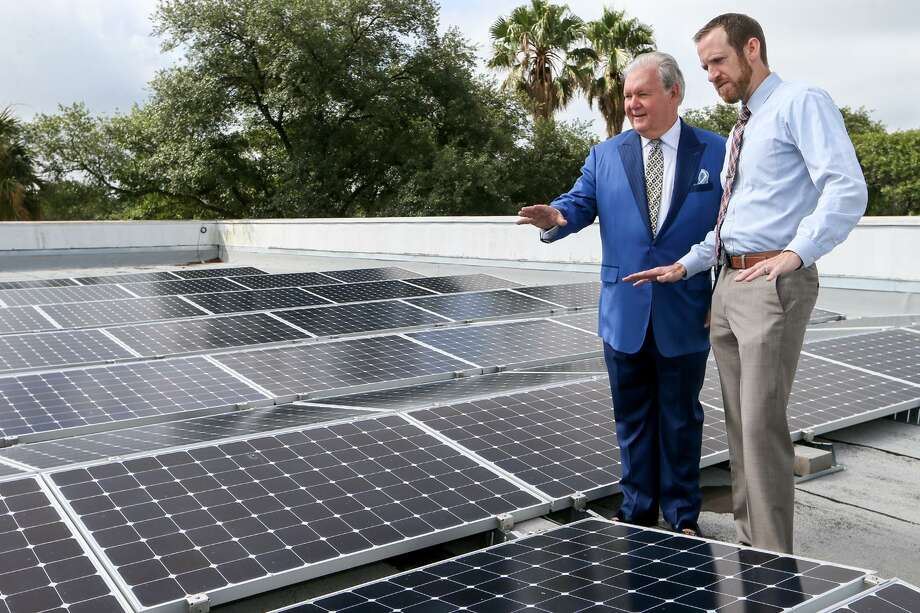 Dick Tips (left), chairman and CEO of Mission Park Funeral Chapels & Cemeteries, looks over an installation of solar panels on the rooftop of Mission Park North, 3401 Cherry Ridge, with Kyle Frazier, director of sales with Freedom Solar, on Thursday, June 29, 2017. The funeral home used a CPS rebate and a federal tax credit program to install a solar panels in May of this year at eight of its locations for a total cost of more than $1 million. Photo: Marvin Pfeiffer /San Antonio Express-News / Express-News 2017