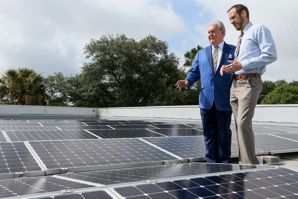 Dick Tips (left), chairman and CEO of Mission Park Funeral Chapels & Cemeteries, looks over an installation of solar panels on the rooftop of Mission Park North, 3401 Cherry Ridge, with Kyle Frazier, director of sales with Freedom Solar, on Thursday, June 29, 2017. Mission Park now has solar panels on eight of its locations.