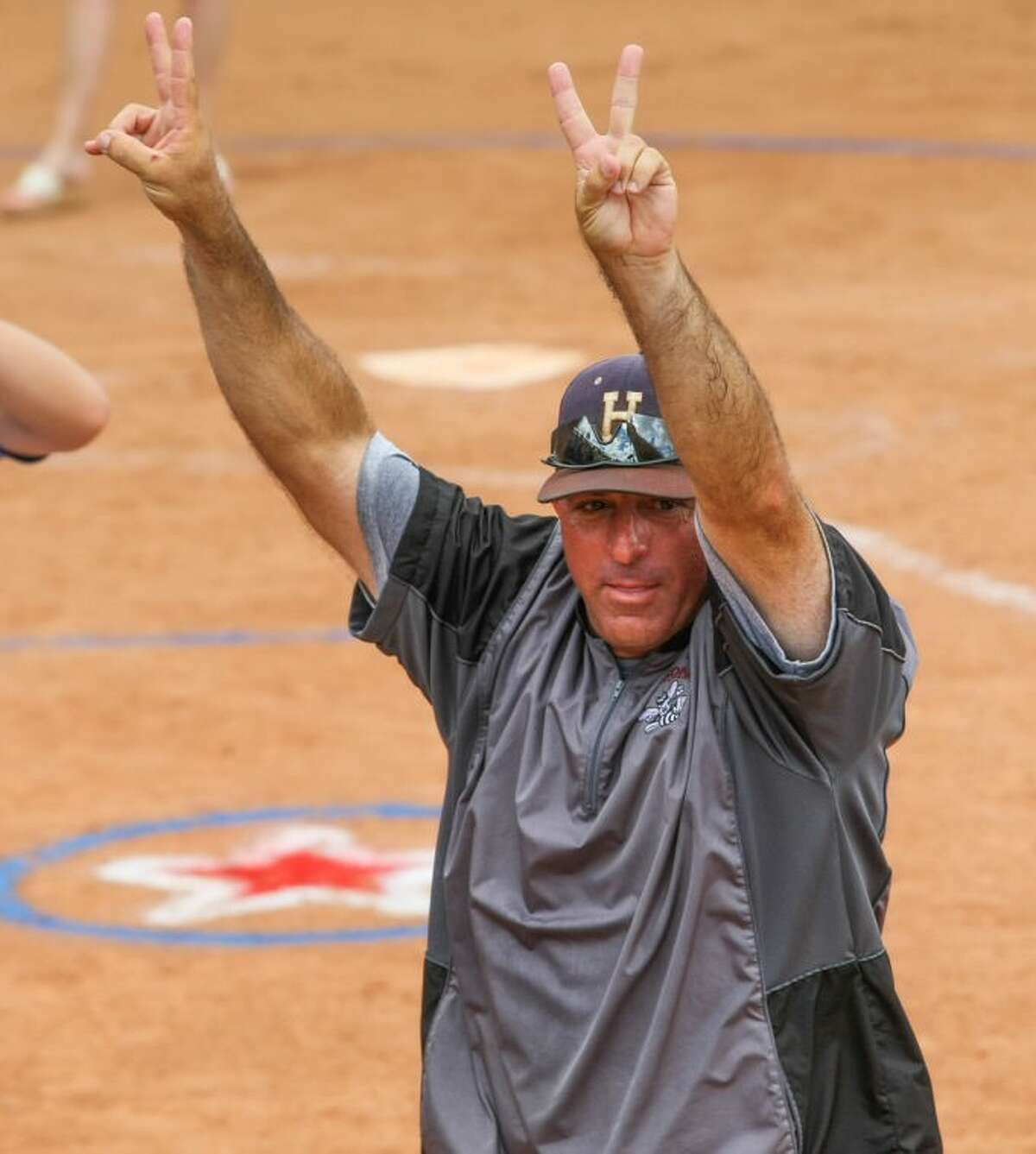 New Magnolia West softball coach Jimmy Eby celebrates the his second straight state championship with Lufkin Hudson on June 1, 2013, in Austin.