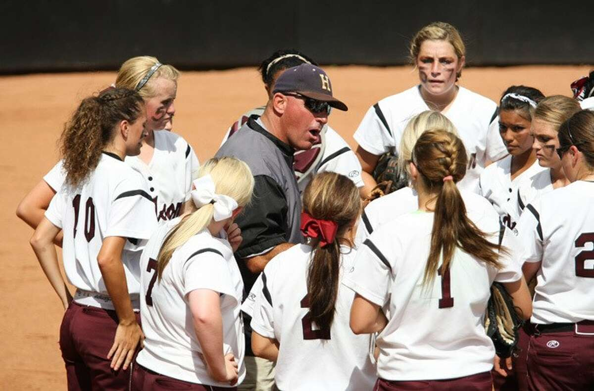 New Magnolia West softball coach Jimmy Eby addresses his Lufkin Hudson team during the state championship gameon June 1, 2013, in Austin.