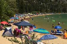 The beach at Sand Harbor, Lake Tahoe Nevada State Park, is packed on Mon., June 19, 2017. In the summer, even Mondays are busy at this popular beach.