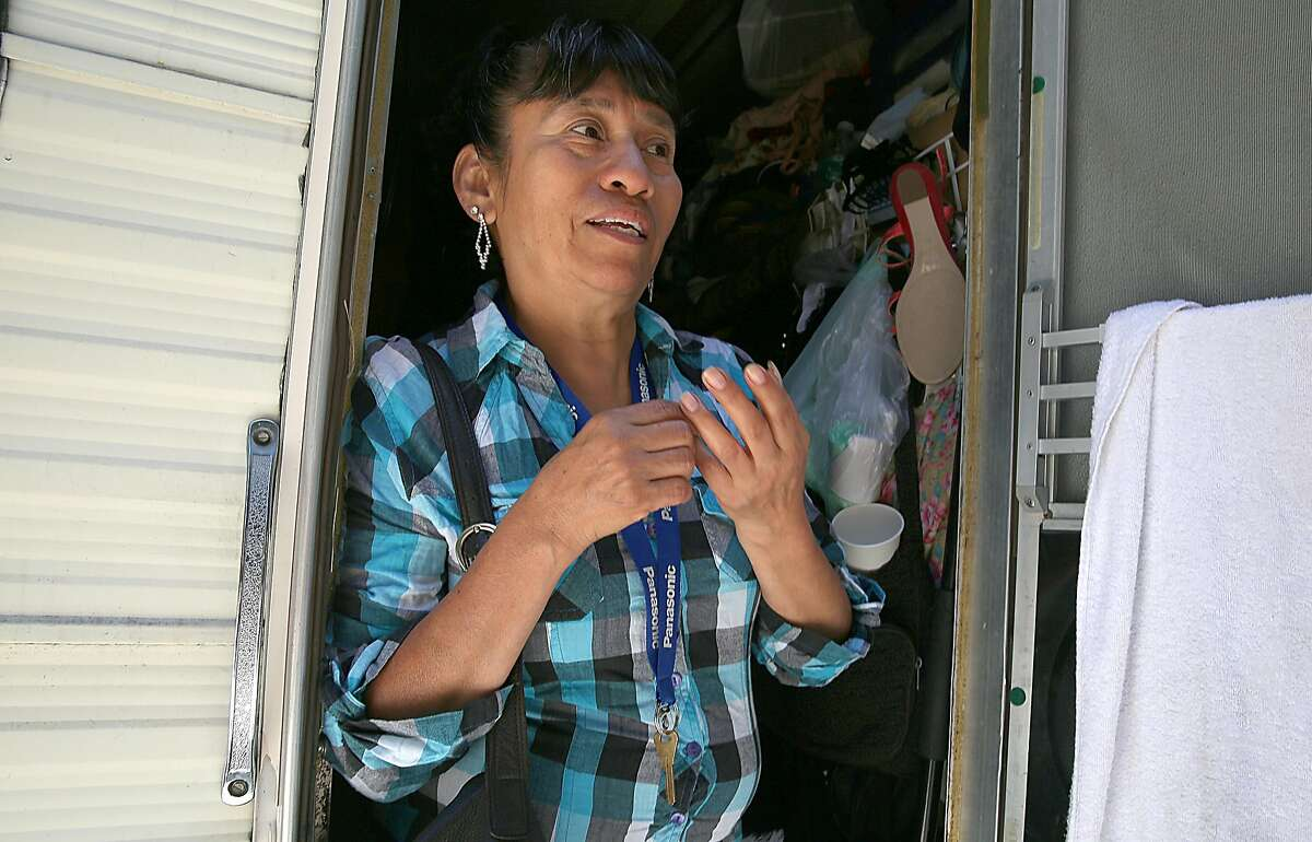 Motor home resident Angela Serrano gets ready to leave for work on Thursday, June 29, 2017, in Palo Alto, Calif. She just found out about the 72-hour parking ordinance for the 50 motor homes parked along El Camino Real.