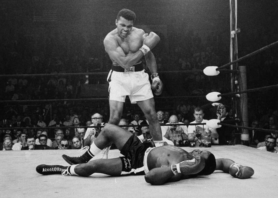 Heavyweight champion Muhammad Ali stands over fallen challenger Sonny Liston, shouting and gesturing shortly after dropping Liston with a short hard right to the jaw in Lewiston, Maine in 1965. Ali was jubilant, but consider the feelings of Liston — the pain of losing greater even than Ali's joy at winning? Photo: JOHN ROONEY /Associated Press / AP