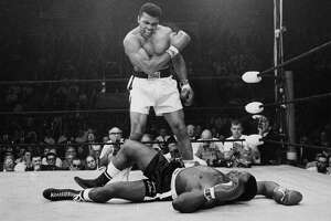 Heavyweight champion Muhammad Ali stands over fallen challenger Sonny Liston, shouting and gesturing shortly after dropping Liston with a short hard right to the jaw in Lewiston, Maine in 1965. Ali was jubilant, but consider the feelings of Liston — the pain of losing greater even than Ali's joy at winning?