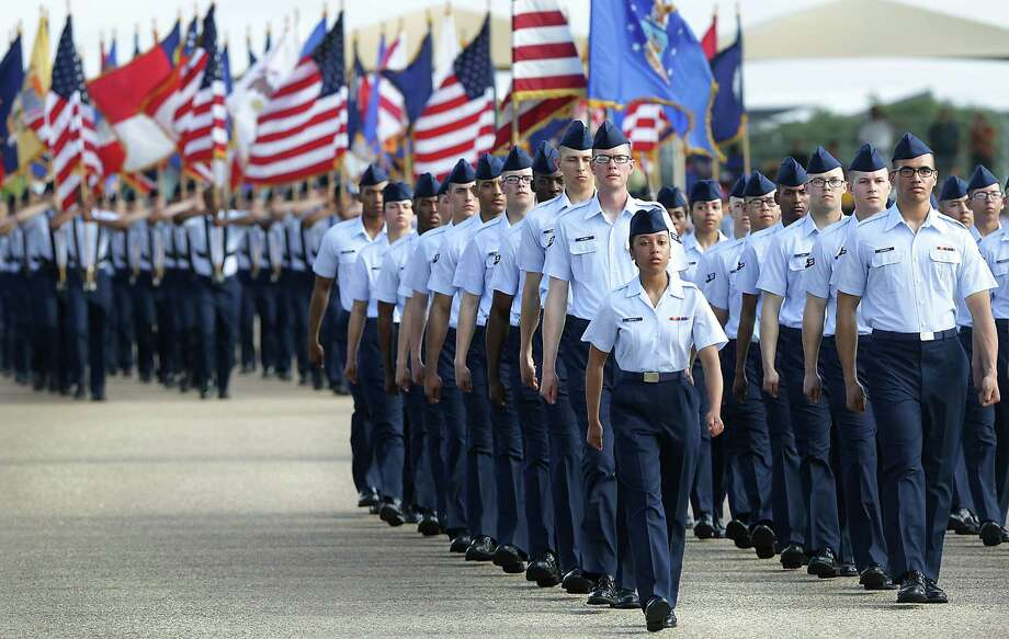 Airmen parade during the basic military training graduation at Joint Base San Antonio-Lackland on June 16. A bill that could be considered in special legislative session, could imperil the city's local bases. Photo: Bob Owen /San Antonio Express-News / ©2017 San Antonio Express-News