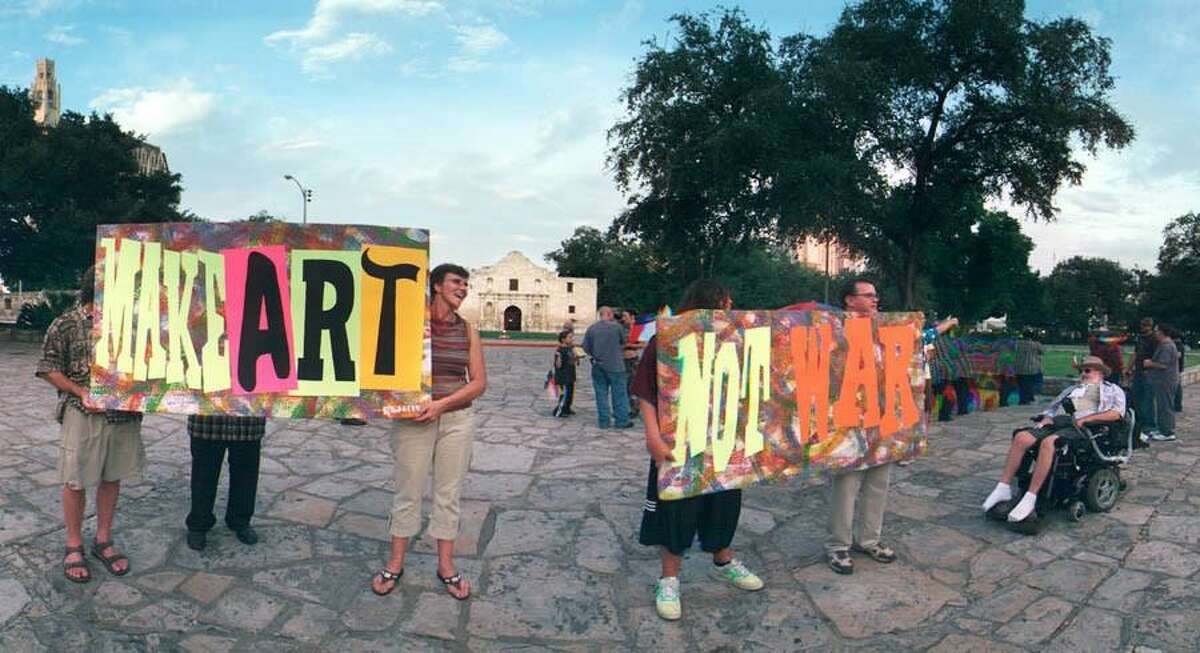 San Antonio artists delivered a political message in front of the Alamo in 2007. Photo by Anson Seale.