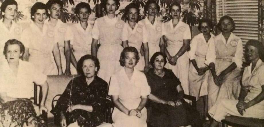 Pictured are Conroe Service League members from 1956-57 year. Left to right: Mrs. J.L. Pitts 56-57, Mrs. Charles Tigner - charter, Mrs. Mark Everett Jr - charter, Mrs. Stanford Pitts - charter, Mrs. Russell Law 56-57, Mrs. C.L. Williamson - charter, Mrs. Jack Nelson 56-57, Mrs. W.C. McClain 56-57, Mrs., Karl Fisher 56-57, Mrs. Oliver Kneisley - charter, Mrs. Seth Gibson - charter, Mrs. T.S. Falvey - sponsor, Mrs. J.N. Simpson, Jr. - sponsor, Mrs. Jack Clarke - charter and Mrs. J. S. Hunt - charter and sponsor.