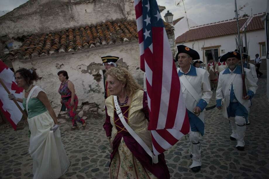 Actors parade as they reenact a battle of the war for U.S. independence during the celebrations in Macharaviaya in Spain on July 4, 2015. It was the seventh time that the village of Andalusia pays tribute to local military leader Bernardo de Galvez for his role helping the 13 colonies to fight for independence. Photo: JORGE GUERRERO /AFP / Getty Images / AFP ImageForum