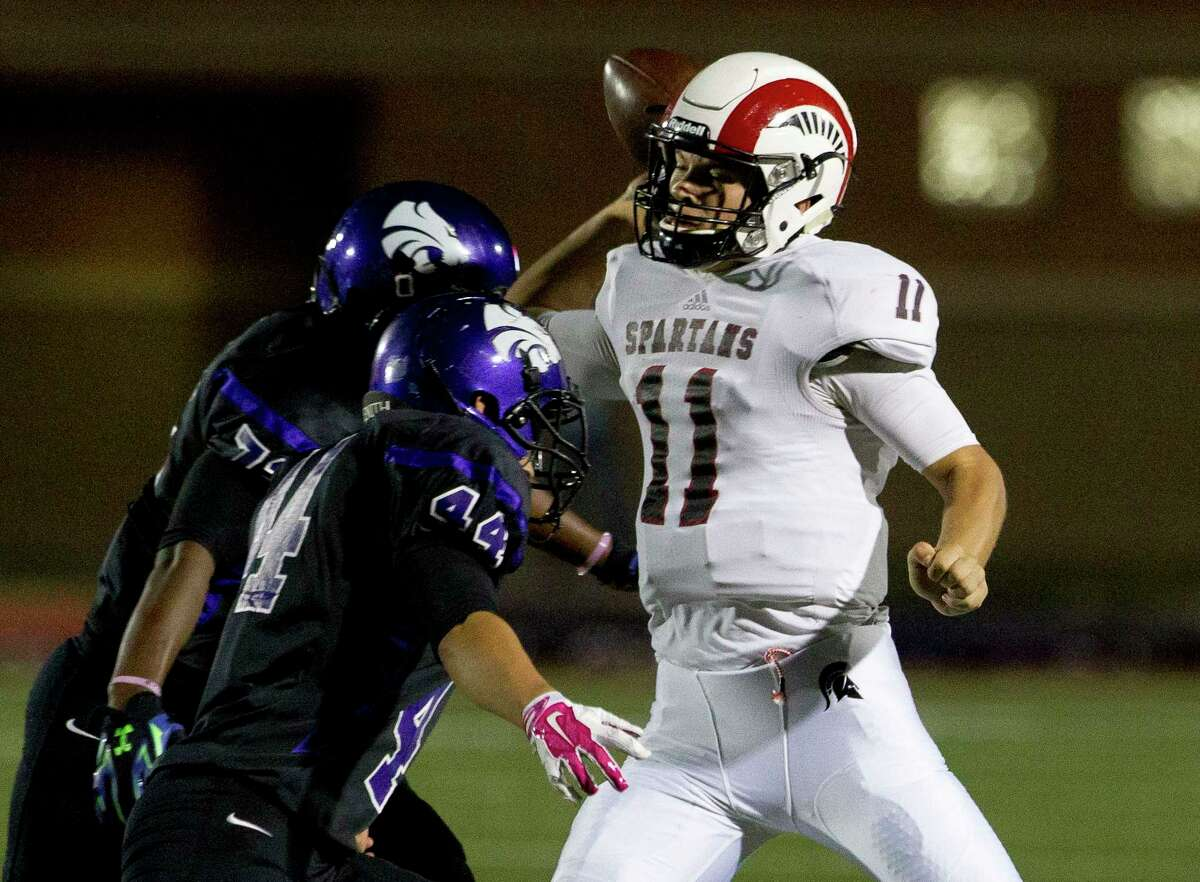 Porter quarterback Jacob Hall (11) throws under pressure by Humble linebacker Christian Olivarez (44) and defensive linemen Dreylon Alford (72) during the third quarter of a District 21-5A high school football game at Turner Stadium Saturday, Oct. 22, 2016, in Humble.
