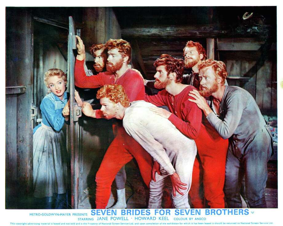 """Jane Powell opens a door to find Jeff Richards, Russ Tamblyn and the rest of the brothers in a scene from the film """"Seven Brides For Seven Brothers"""" (1954). Photo: Metro-Goldwyn-Mayer / Getty Images / 2012 Getty Images"""