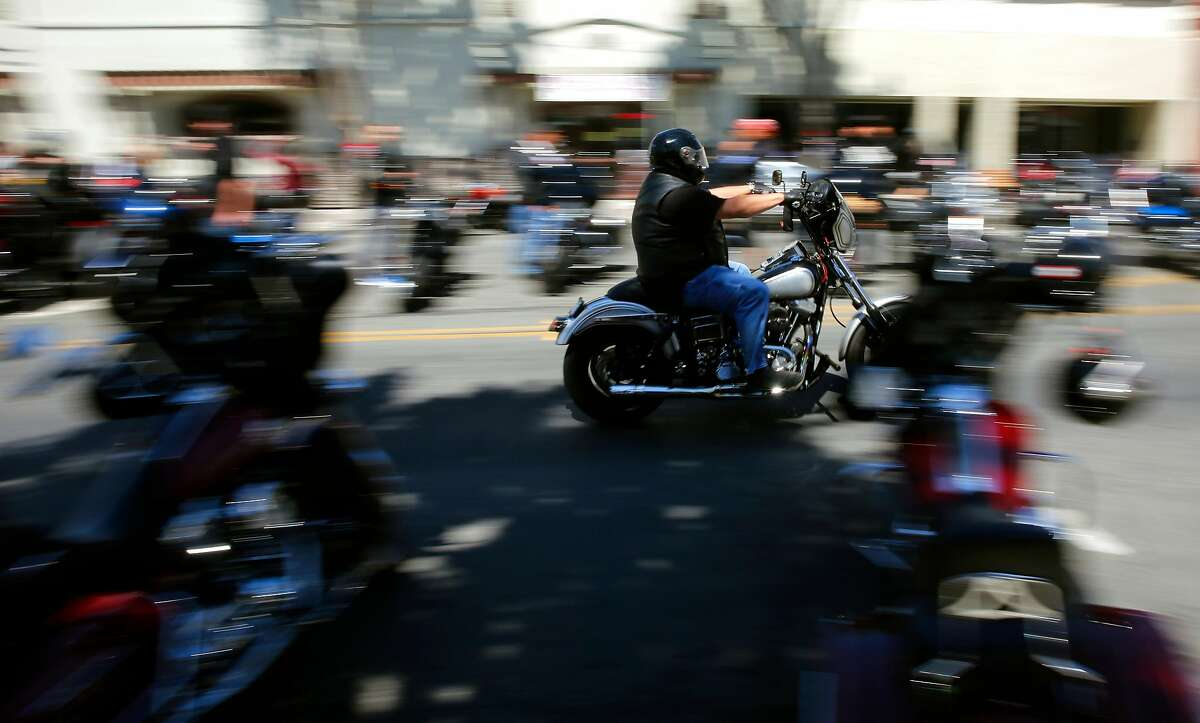 Motorcycle riders gather on opening day marking the 70th anniversary of the Hollister Independence Rally on Friday June 30, 2017, in Hollister, Ca.
