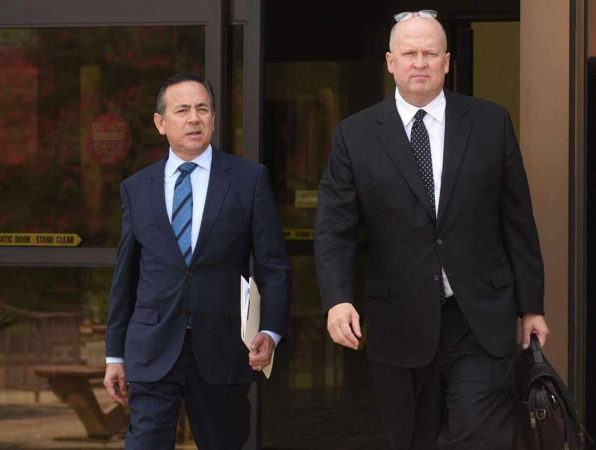 State Sen. Carlos Uresti, left, and attorney Mikal Watts leave the U.S. Federal Courthouse on Friday. Prosecutors allege Watts has a conflict of interest and are seeking to disqualify him as Uresti's lawyer in a fraud case involving FourWinds Logistics, a defunct oil-field services company.