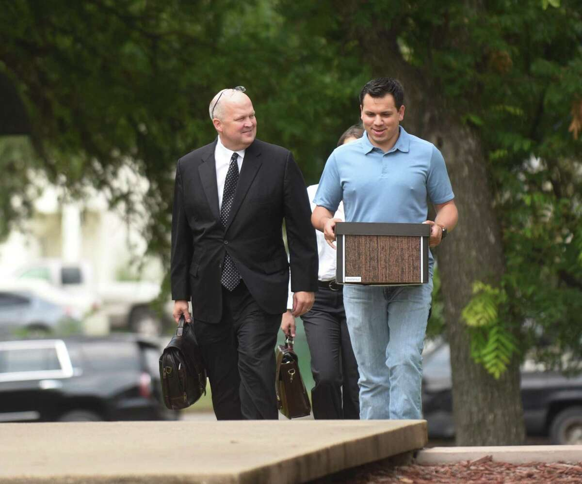 U.S. Magistrate Judge Henry Bemporad on Friday determined that attorney Mikal Watts, left, has a conflict of interest in representing state Sen. Carlos Uresti. But the judge deferred ruling on whether the lawyer should be disqualified.