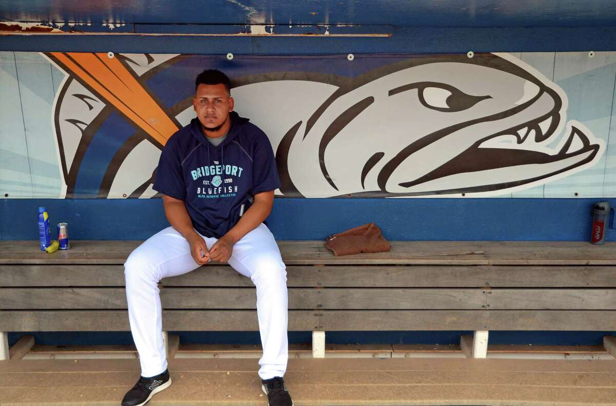 Bridgeport Bluefish player Rainy Lara sits in the dugout before game action against the York Revolution at the Ballpark at Harbor Yard in Bridgeport, Conn., on Thursday June 29, 2017.