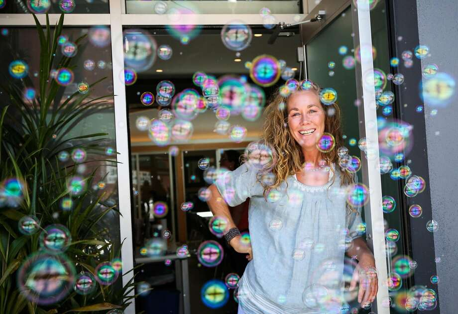 Kristie Fairchild, the executive director of the North Beach Citizens center stands for a portrait after putting on a bubble machine in front of the homeless drop- in center in San Francisco, California, on Tuesday, June 27, 2017. She says the bubbles help people who are agitated to relax as they come through the doors of the center. Photo: Gabrielle Lurie, The Chronicle