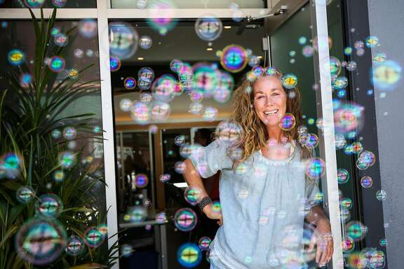Kristie Fairchild, the executive director of the North Beach Citizens center stands for a portrait after putting on a bubble machine in front of the homeless drop- in center in San Francisco, California, on Tuesday, June 27, 2017. She says the bubbles help people who are agitated to relax as they come through the doors of the center.