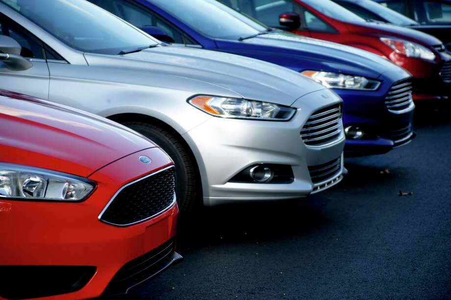 FILE - In this Thursday, Nov. 19, 2015, file photo, a row of new Ford Fusions are for sale on the lot at Butler County Ford in Butler, Pa. Ford Motor Co. has built the midsize Fusion sedan at its plant in Hermosillo, Mexico, since its introduction in 2005.  Ford has announced that it is shifting production of the Fusion from Mexico to China in 2019. (AP Photo/Keith Srakocic, File) Photo: Keith Srakocic, STF / Copyright 2016 The Associated Press. All rights reserved. This material may not be published, broadcast, rewritten or redistribu