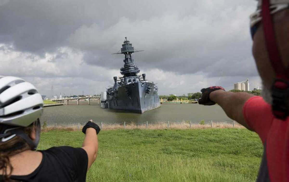 Sara and Javier Montoya stop for a view of the 103-year-old Battleship Texas. Workers are trying to correct the ship's tilt.