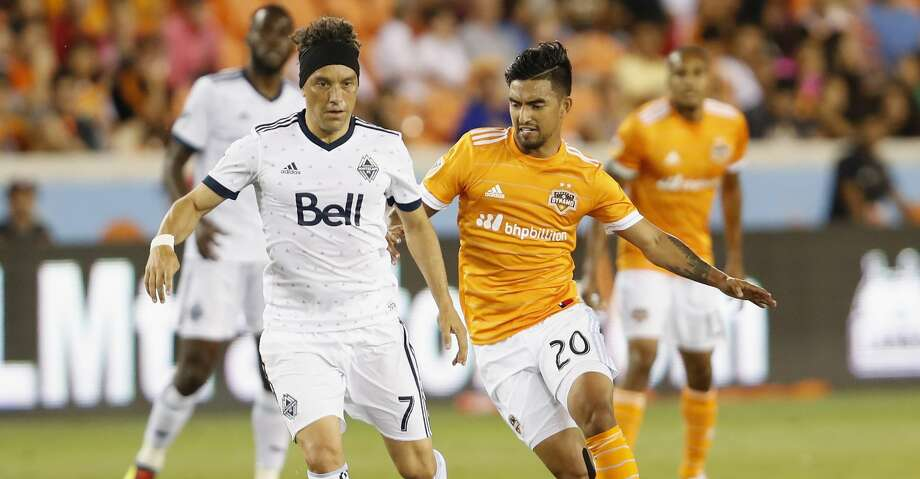 Vancouver Whitecaps midfielder Christian Bolanos (7) controls the ball defended by Houston Dynamo defender A. J. DeLaGarza (20) in the first half during the MLS game between the Houston Dynamo and the Vancouver Whitecaps at BBVA Compass Stadium on Friday, May 12, 2017, in Houston, TX. Photo: Tim Warner/For The Chronicle