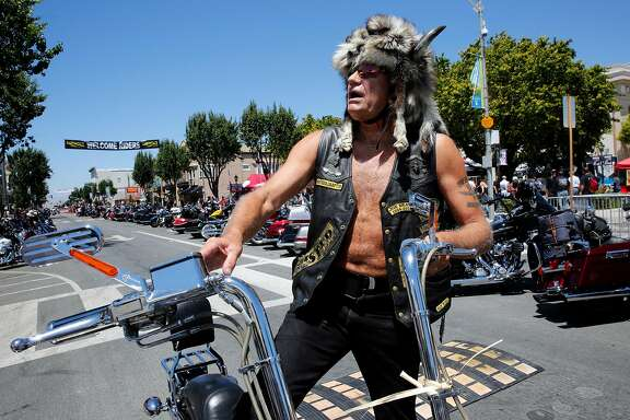 "Bob ""Side Show"" Poelker of Hollister, climbs onto his motorcycle on opening day marking the 70th anniversary of the Hollister Independence Rally on Friday June 30, 2017, in Hollister, Ca."