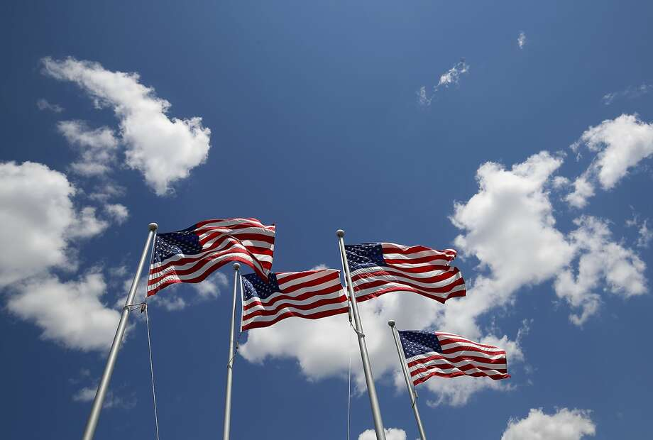 American flags fly outside of the FlagSource factory in Batavia, Ill. Photo: Jim Young, Bloomberg