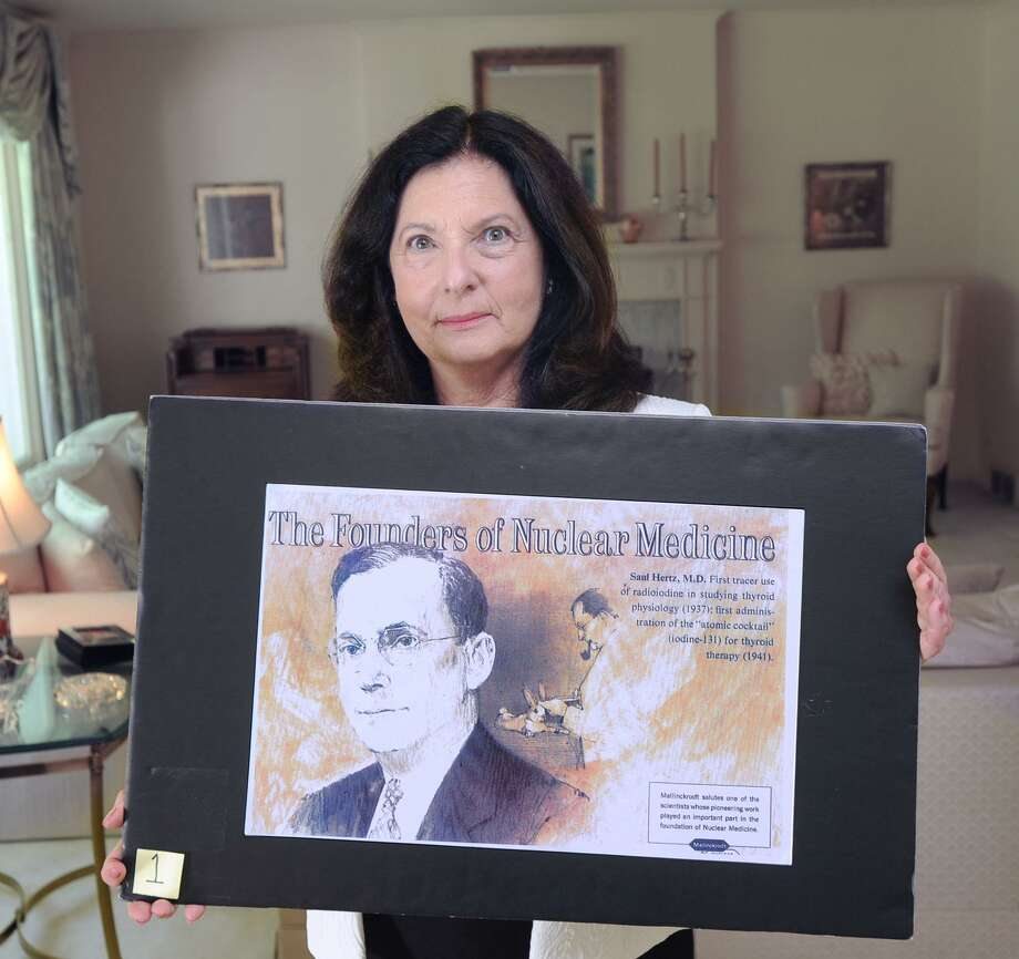 Barbara Hertz holds a poster featuring her late father Dr. Saul Hertz at her home in Greenwich, Conn., Friday, June 30, 2017. Dr. Hertz discovered the use of radioactive iodine for the treatment of thyroid disease. Photo: Bob Luckey Jr. / Hearst Connecticut Media / Greenwich Time
