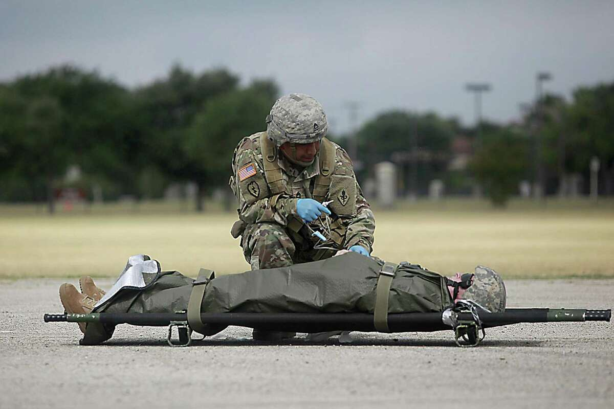 U.S. Army Medical Service Corps hosted a MEDEVAC demonstration at the Fort Sam Houston parade field on June 30, 2017. In the demonstration a MEDEVAC crew member helps a wounded solider in a staged battle field.